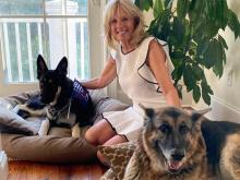 Jill Biden poses with Major and Champ.
