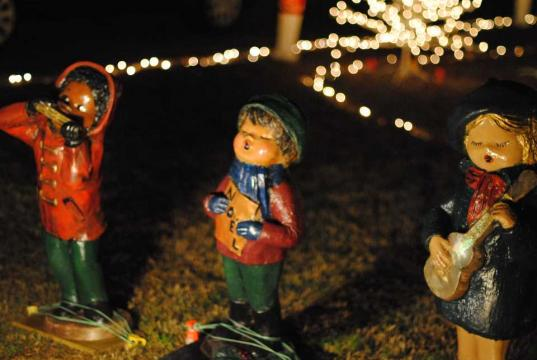 The vintage carolers and manger scene also belonged to the Cross family holiday display. There were restored by the Moore family, and now stand as part of Happyland.