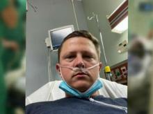 Man battling COVID pleads with people to wear masks
