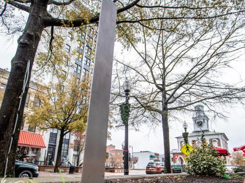 A mysterious metallic monolith has appeared in downtown Fayetteville, sparking curiousity from locals and merchants.
