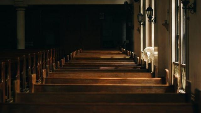 Empty Church pews. Photo from Pexels, taken by Nikko Tan.