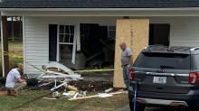 IMAGES: Woman charged after car slams into Wendell home