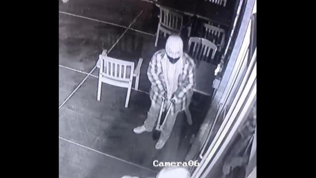 Two men were seen breaking into Babymoon Cafe. One man smashed the glass door with bolt cutters.