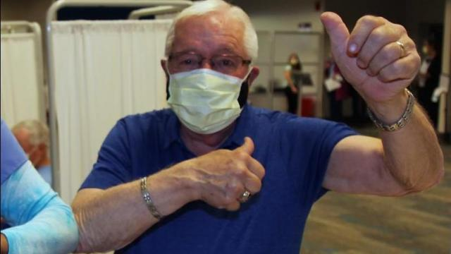 Dick Sears, mayor of Holly Springs, celebrates after he got the first dose of the COVID-19 vaccine.