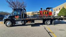 IMAGES: Cary Towne Center train takes final ride, towed away from the mall
