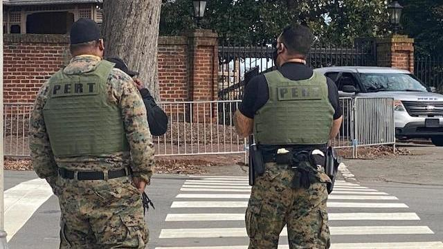 Officers in PERT (Prison Emergency Response Team) vests are stationed downtown