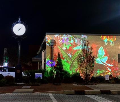 Downtown Cary's series GLOW brings a surprise pop-up virtual reality wall to Academy Street.
