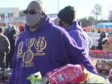 On day of service, feeding families in Raleigh