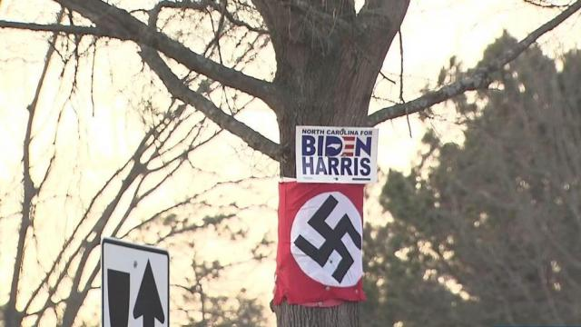 Wake Forest community outraged by Nazi flag posted below 'Biden Harris' sign