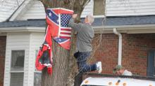 IMAGES: Nazi flag removed, property owner silent