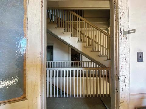 The stairwell to the meeting chambers as seen through an office door.