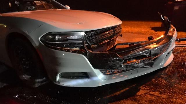 Trooper's car damaged in high-speed crash