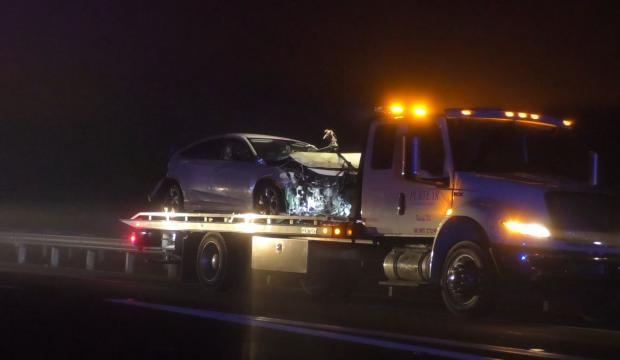 Suspect's car damaged in crash