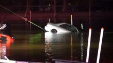 IMAGE: Car with body inside pulled from lake off I-95 near Selma
