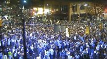IMAGES: UNC fans rush Franklin Street after Duke win, despite warnings not to gather