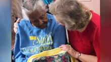IMAGE: Local Santa, Mrs. Claus gift Valentine's Day blankets to isolated seniors in nursing homes