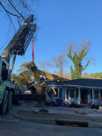 Crane crashes through roof of Raleigh home