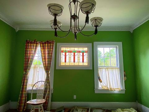 Owls Nest Properties discovered a beautiful stained-glass window in the Elizabeth Makepeace House, hidden behind a mirror for years. It's likely an original piece of the historic home.