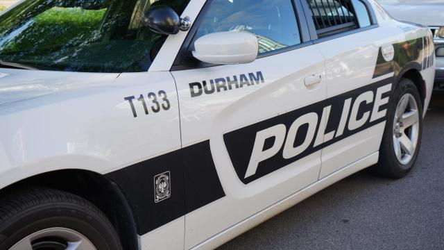 A Durham Police car is parked outside of the Durham Police Headquarters on East Main Street.