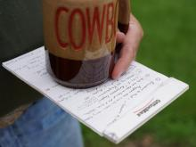 Cowboy holding Cowboy coffe cup, notes on prepping