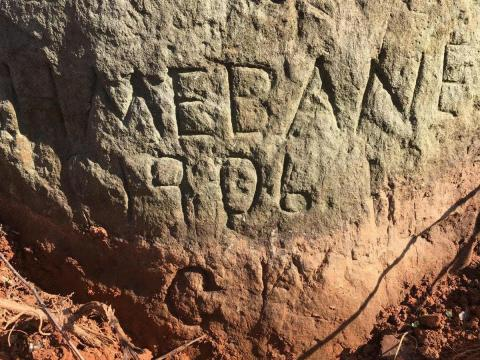 Stagecoach Rock has names carved near the base as well, possibly indicating more names hidden beneath the ground. (Photo courtesy of Gary Clark)