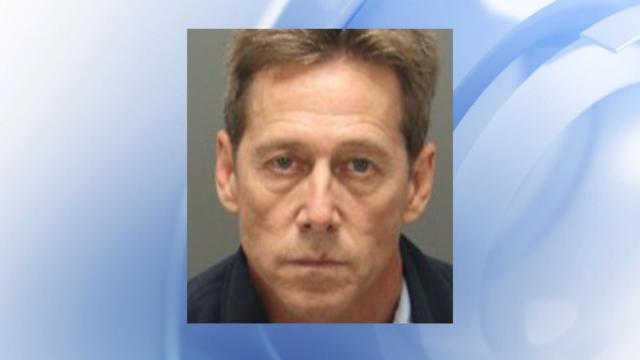Dana Lynn Dean, 54, turned himself in Friday after a months-long investigationand was being held in the Wake County Detention Center under a $1 million bond, the sheriff's office said.