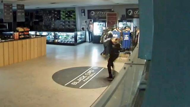 Surveillance video captured a single robber in a hoodie, black pants and a backpack running across the showroom at  Black Ops Paintball in Fayetteville.