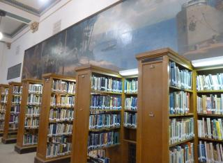 Above the bookshelves in the Hibbing High School library is part of a 60-foot-long mural showcasing the region's long relationship with iron ore history. Dylan publicly stated the mural was an early influence on his art. (Deseret Photo)