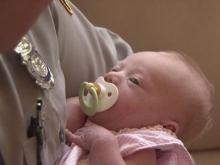 State Trooper J.L. Thorpe holds 1 1/2-week-old Ailey Simmons, who he helped deliver at N.C. Highway 42 and N.C. Highway 50 on late Saturday, June 28, 2008.