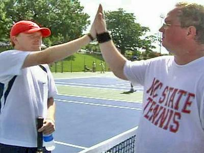 Stuart Goodmyn, of Raleigh, high-fives a fellow competitor in the Special Olympics North Carolina Midsummer Tournament at North Carolina State University on Saturday, July 19, 2008. Goodmyn has played in the games for four years.