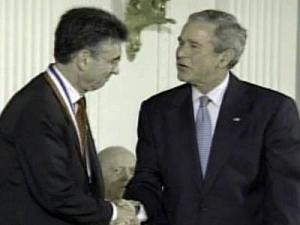 President George W. Bush shakes hands with Dr. Robert Lefkowitz of Duke University after presenting him with the National Medal of Science on Sept. 29, 2008.
