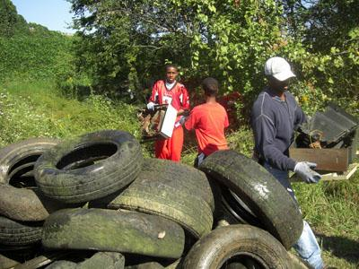 Volunteers pick up tires during the Big Sweep clean-up of Walnut Creek in Raleigh on Oct. 4, 2008. (Submitted by: Partners for Environmental Justice)