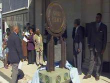 Durham officials unveiled three sculptures on Parrish Street to honor the legacy of economic achievement and opportunity created a century ago by local black entrepreneurs.
