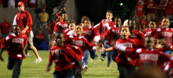The Garner Civitan Mitey Mite Blue Trojan youth football team stormed the field in front of more than 55,000 college football fans before N.C. State-Florida State game Oct. 16. (Submitted by: Carol Rich)
