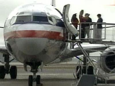 A chartered American Airlines plane arrives to pick up families of fallen soldiers for the Snowball Express trip to Disneyland.