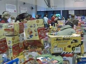 Parents pick out donated toys at the Salvation Army Community Center on Wake Forest Road in Raleigh to give to their children as Christmas presents.