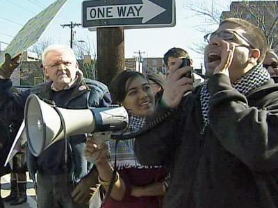 A group of Durham residents opposed to the Israeli air strikes in Gaza speak during a demonstration on the corner of Main and Gregson Streets in Durham on Jan. 3, 2009.