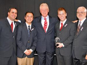 From left: Mike Giancola, N.C. State University Center for Student Leadership, Ethics & Public Service, Vansana Nolintha, NCSU student, Former President Bill Clinton, John Coggin (award winner) Ray Buchanan, Stop Hunger Now