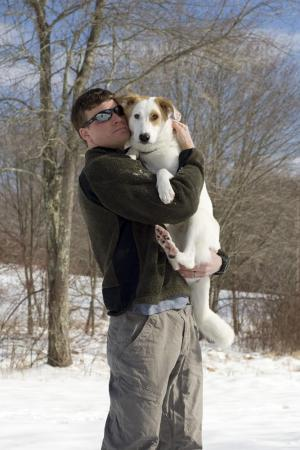 Sgt. Daniel Barker holds Jack after their homecoming in Fayetteville. Barker rescued Jack as a puppy from the streets of war-torn Afghanistan, and Dogpile.com arranged for Jack to come to a new home in America. (Photo courtesy of Dogpile.com)