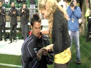 Carolina Railhawks midfielder/defender Caleb Norkus proposed to his girlfriend Danielle Fernandez after she sang the National Anthem before a game on Saturday, March 14, 2009.