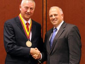 Elon University President Leo M. Lambert presented the school's inaugural medal for entrepreneurial leadership to Jim Goodnight on Thursday.