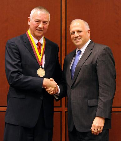 Elon University President Leo M. Lambert presented the school's inaugural medal for entrepreneurial leadership to Jim Goodnight on Thursday.