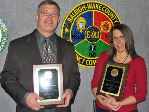 Kevin Anderson (right) was named Employee of the Year, and Heather Fletcher (right) as Rookie of the Year at the Raleigh-Wake 911 Emergency Communications Center. Raleigh Mayor Charles Meeker presented plaques to them at an April 7 City Council meeting. (Photo courtesy of the Raleigh-Wake 911 Emergency Communications Center)