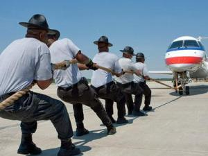 Team Smokey Bears, State Troopers tries to pull a 30,000 pound plane during the annual Plane Pull at RDU on April 25, 2009. (Image from Paul Stackhouse)