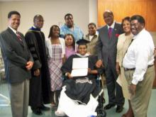 Family and Shaw University officials surround Edgar Huff after his graduation ceremony at Pitt Memorial Hospital on Friday, May 22, 2009. Huff, a baseball star and holder of a 3.6 GPA, was seriously injured in a wreck with an alleged drunken driver on May 5, 2009, four days before the college's commencement exercises. (Photo courtesy of Shaw University)