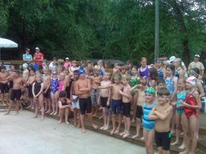 Eight- to 10-year-old children line up Saturday for the swim portion the KIT Youth/Family Triathlon.