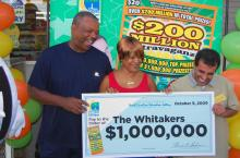 "Ricky and Regina Whitaker won $1 million in the North Carolina Education Lottery ""$200 Million Extravaganza"" scratch-off game. They purchase the ticket at from David Moharram (right) at the Stantonsburg Friendly Mart."