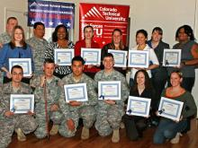Four wounded Fort Bragg soldiers and 15 spouses received full college scholarships to Colorado Technical University during an awards luncheon Wednesday at the Fort Bragg Officer's Club.