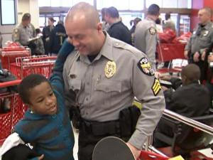 Apex police officers bought gifts for kids Saturday at Super Target.