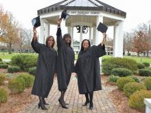 Lisa Meadows, Cheryl Taylor and Tammy Matthews celebrate their graduation from Mount Olive College on Saturday, Dec. 12, 2009. (Photo courtesy of Mount Olive College)